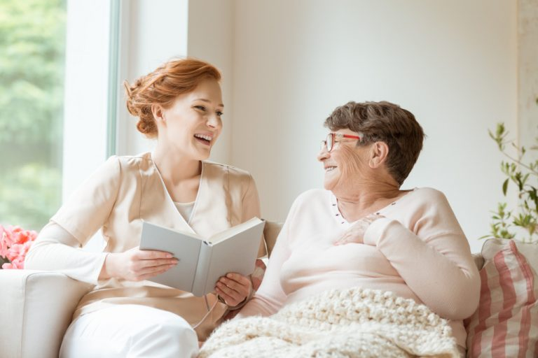 woman telling a story to an elderly woman