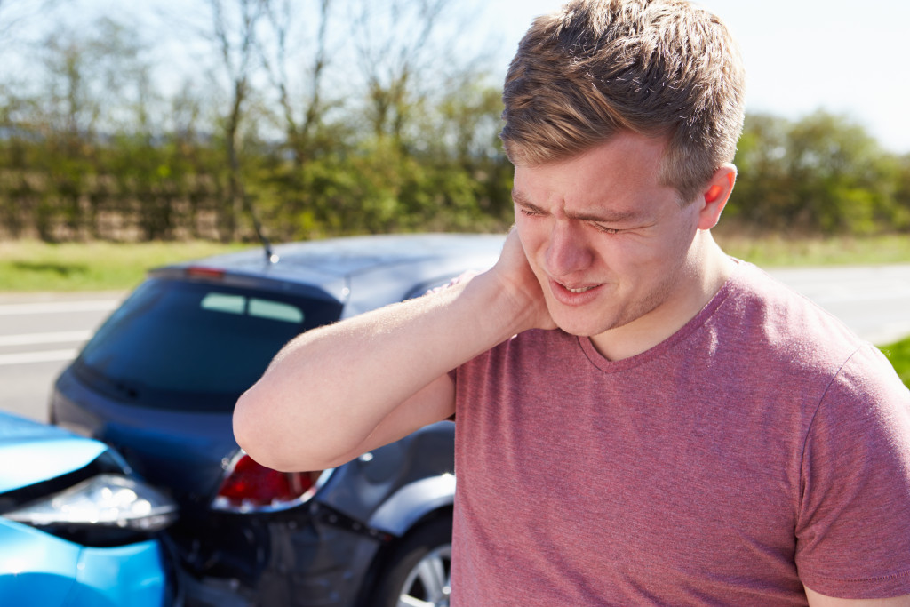 man in pain after car crash