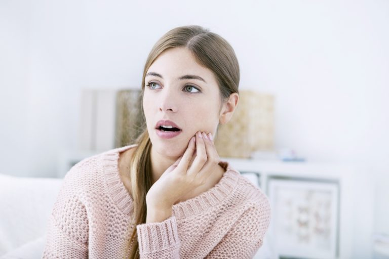 woman with tooth ache