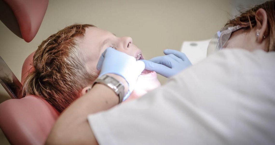 kid at dentist check up